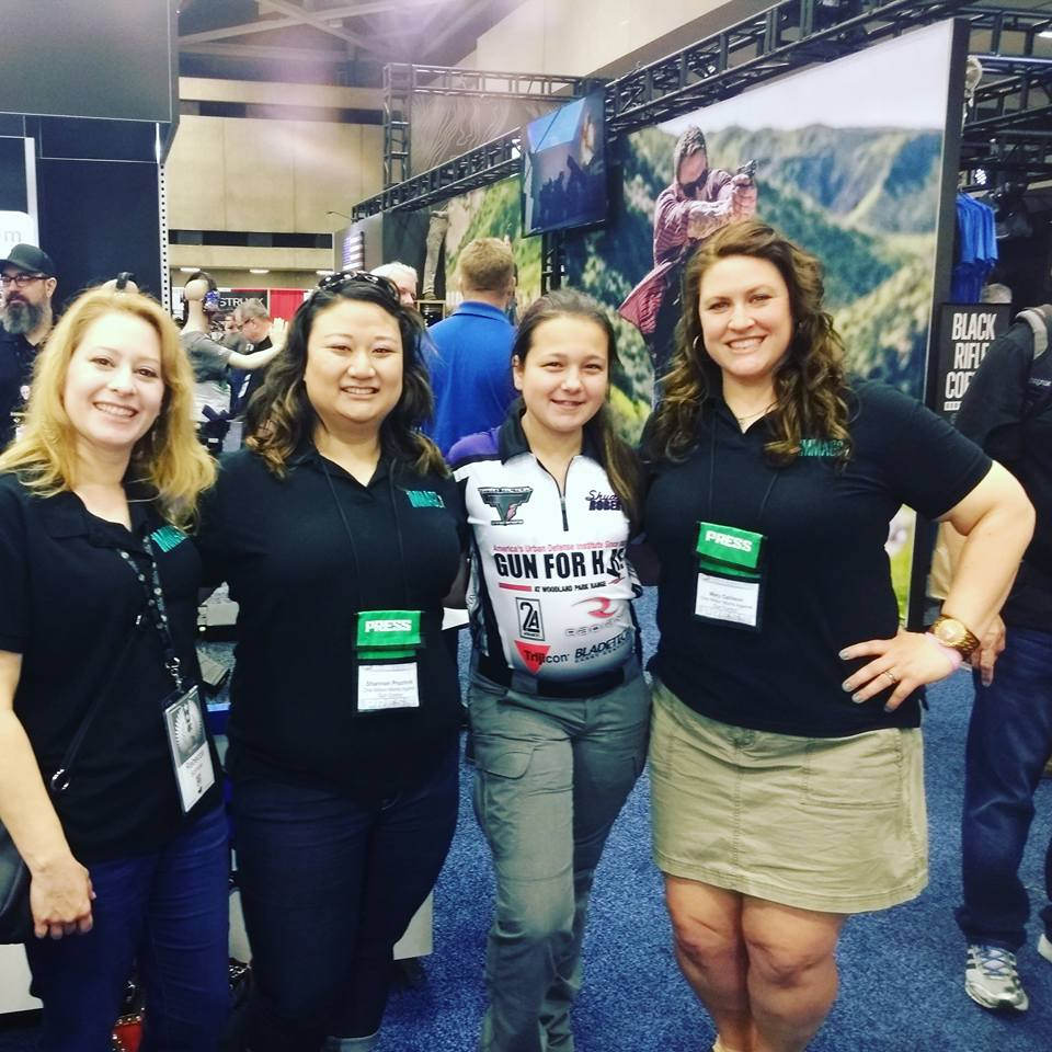 Rebecca Schmoe, Shannon Pruchnik, and Mary Callison with our  talented and wonderful youth shooter friend Shyanne Roberts.