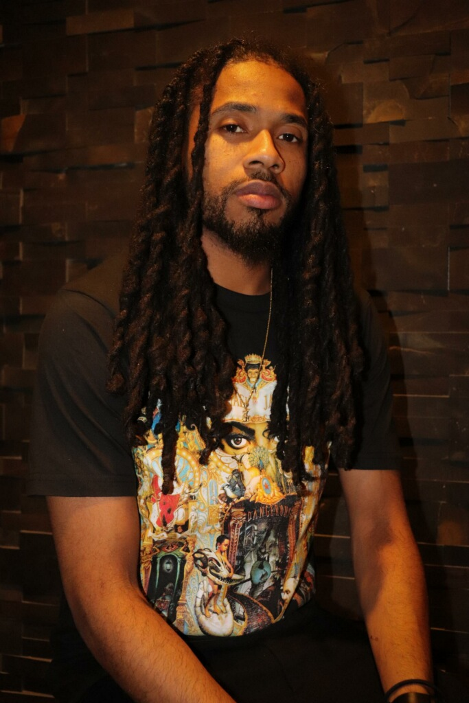 Denzel Pugh - Head of A&R   Denzel, a native of Spencer, Oklahoma is a very passionate individual with a love for music, the creative arts, and anyone who is able to express themselves using the arts as a medium. Vibes are his calling card and is the first step used in making connections which eventually led to becoming a solid member within the 808 Family. Part Scientist (Grad Student) and Part A&R, Denzel quickly learned that skills and interest in different areas are beneficial in becoming an overall well rounded, balanced, and efficient individual capable of completing any challenge or goal placed in his path.