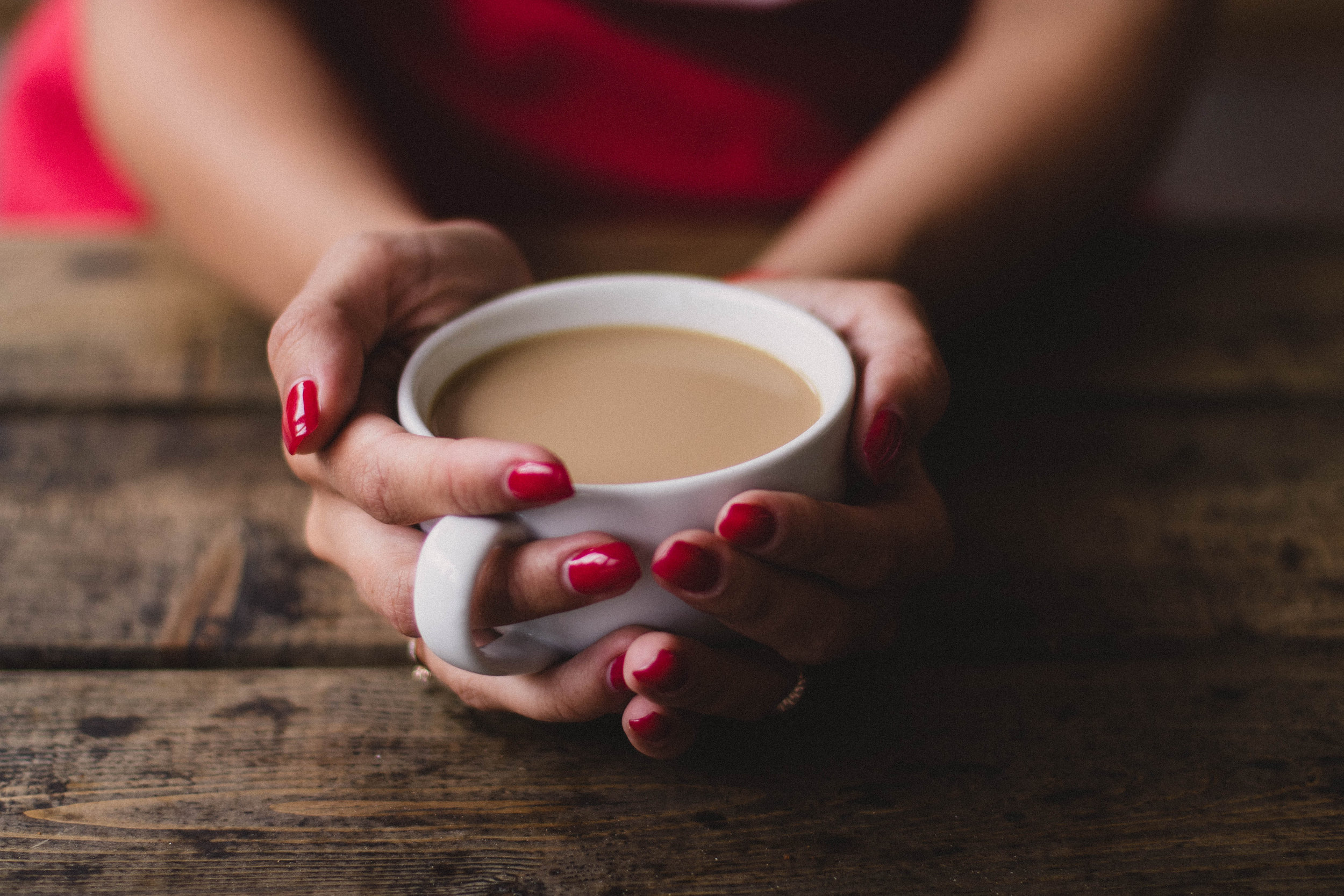 Canva - Women Holding Cup Of Coffee.jpg