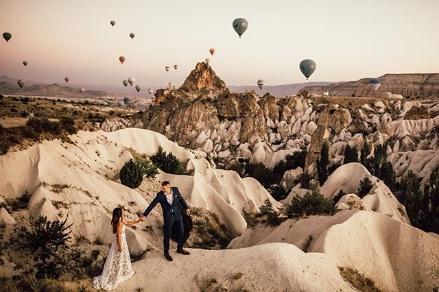 Ever wondered what a magical land actually looks like? I have. And I found it. Thanks to Michelle and Rustin, who eloped in Cappadocia, Turkey. What a dream this was. For these two adventurous souls to fly me over from South Africa to capture their elopement was such a highlight of my year.  Truly a next-level-special experience. We managed to find a deserted spot somewhere in the valley. Not a soul to be found, just us three. Suddenly we were surrounded by all the balloons. I will never forget the sound of the gasburners in the sky, waking up the otherwise silent valley. What a place to say your vows. My, oh my. It's like somebody indeed found the genie in the lamp, wished for a magical land, and there you have it - Cappadocia.  There were balloons, fairy chimneys, camels, magic kilim carpets and and and.  I could go on forever.  These two have become my friends and I'm sure that we'll see each other again one day.  Until then, I'm going to probably over-post this elopement with all I've got.  #elopement #elopementlove #elopementphotographer #authenticlovemag #loveauthentic #elopementlove #wanderingweddings #couple #adventureweddingphotographer #adventureelopement #visitcappadocia #cappadociaturkey #cappadociaballoon #cappadociawedding #elopementcollective #radstorytellers #dirtybootsandmessyhair #cappadociaelopement