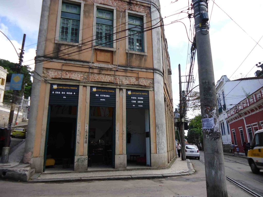 Beloved Santa Teresa, facing Cine Santa, the adorable cinema; also see the bonde tracks, narrow sidewalks, and racing van