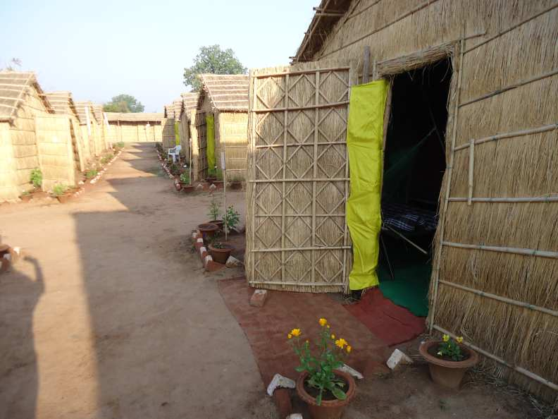 A strip of yellow silk in the doorway brightens up our huts