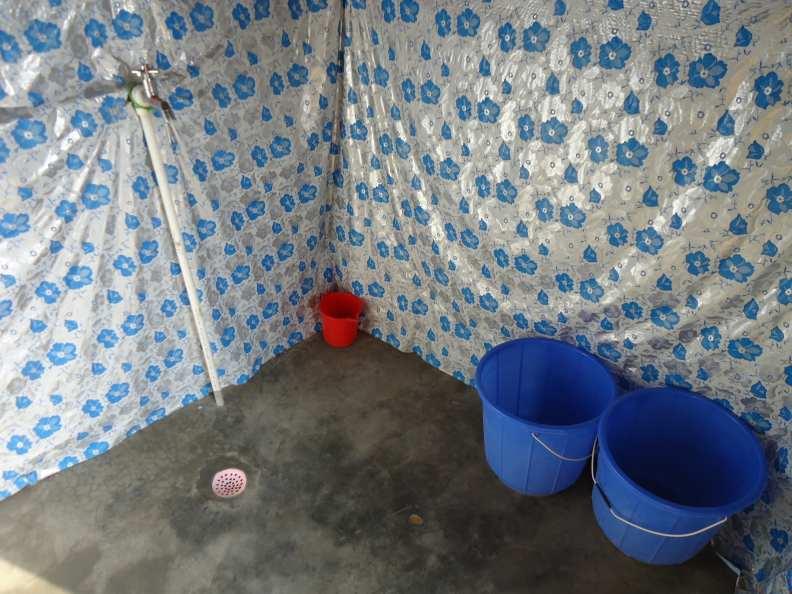 Bucket bath set up–close up. Basic, basic, basic.
