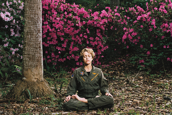 Paula Puopolo in old flight suit in her Florida garden  Photo Credit: Mackenzie Stroh