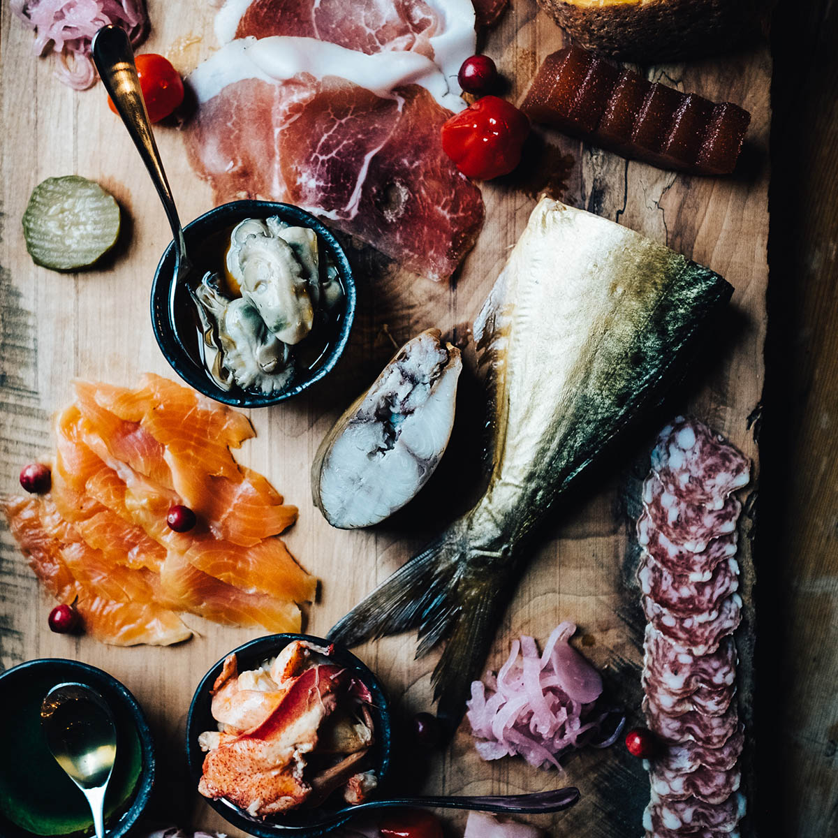 House-made, imported and domestic cured meats are accompanied by mustards, compotes, pickles and nuts on a Big Tree Catering charcuterie board.