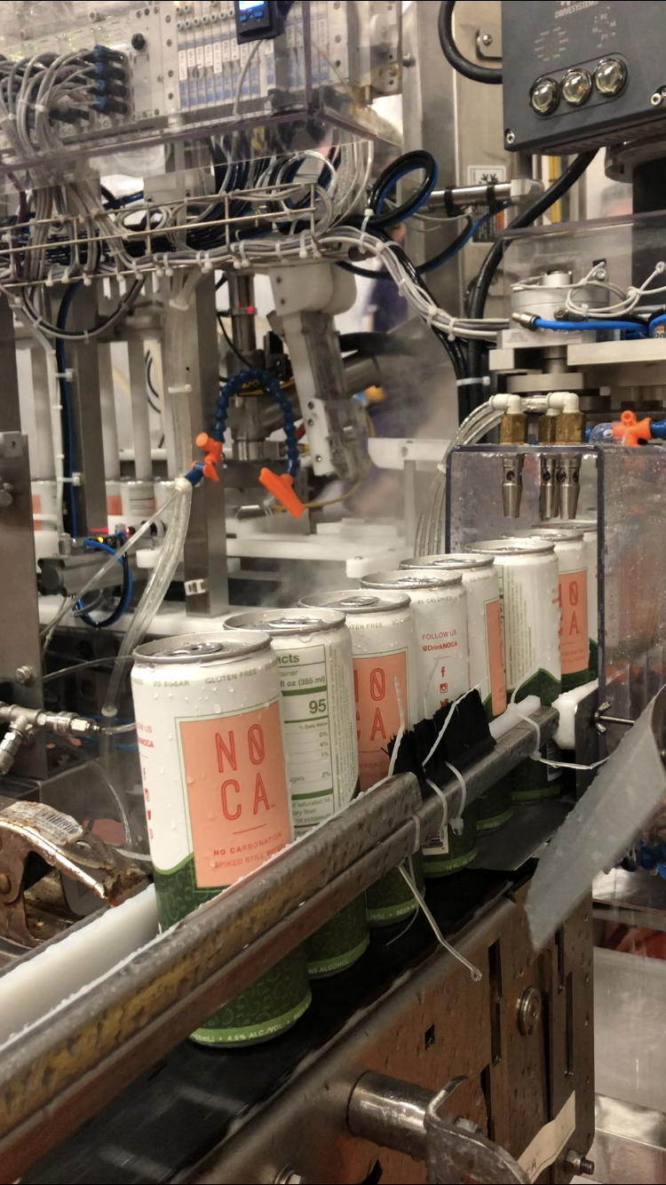 NOCA, spiked water designed by a Newmarket startup, rolls off an assembly line at a contract packaging facility in Baltimore.