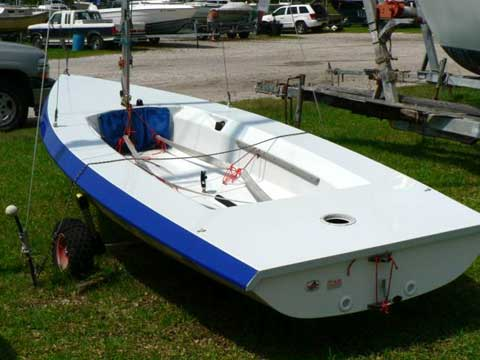 Another of the design features of the boat is to be self bailing or self rescuing meaning that if the shallow cockpit of the boat takes on water, large drains in the stern of the boat will allow the water to drain via gravity and with no effort by the crew or need for the boat to be moving to drain.