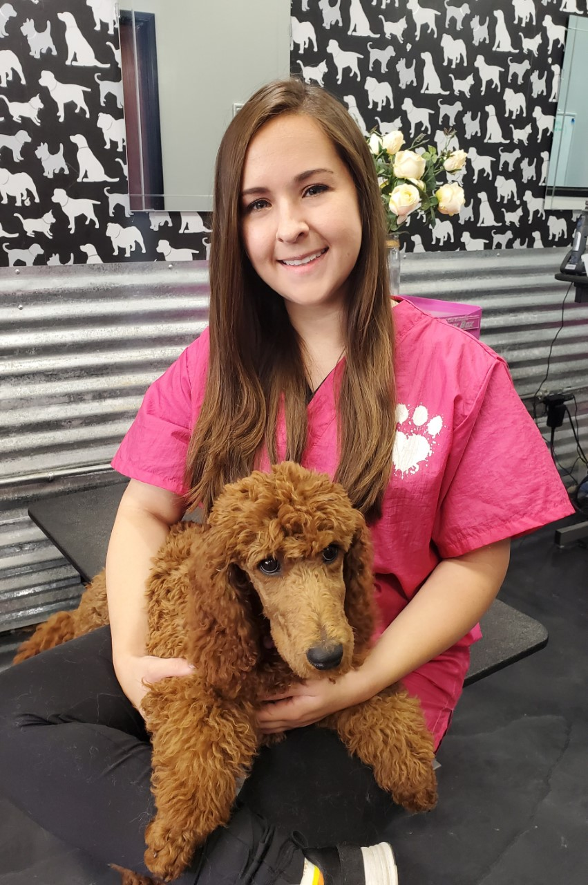 Meet Emily!   I am an academy educated pet stylist that has been in the industry since 2012. Working with animals has been a dream of mine since childhood, and I am lucky enough to pursue my passion in the grooming business. One of my favorite parts of grooming is building bonds with the clients and their fur babies. I absolutely love the environment and challenges that grooming presents. I could not imagine myself doing anything else. When I'm not grooming, you can fine me behind a camera.