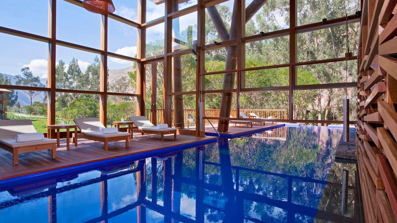 Indoor pool area adjacent to spa