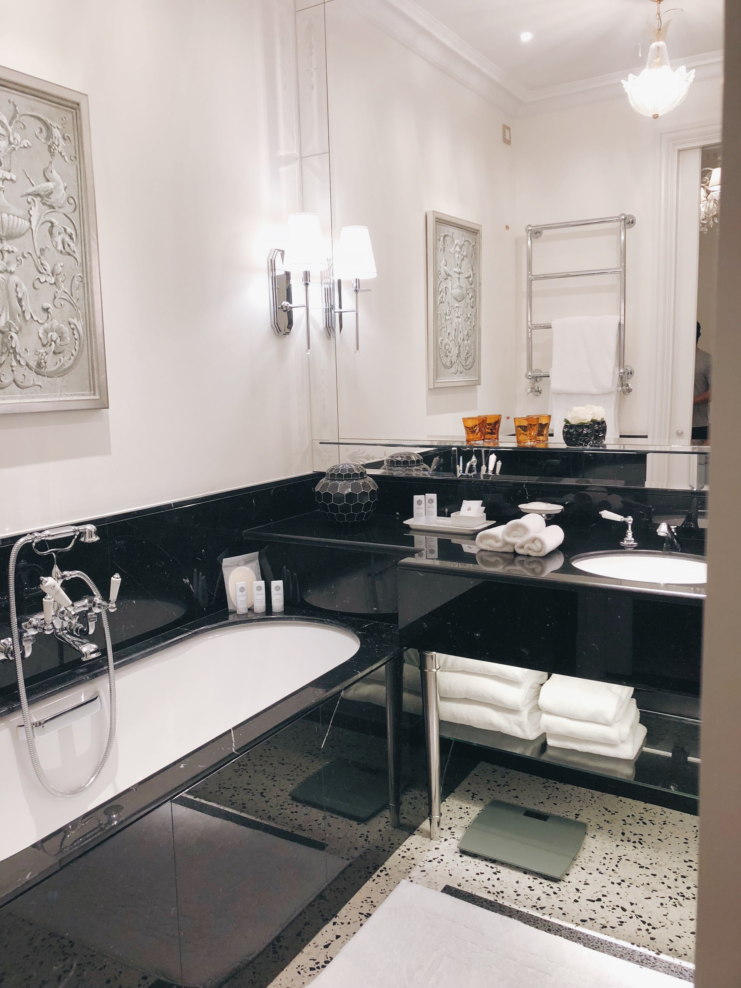 Black marble bathroom with soaking tub, separate shower, and water closet (with toilet and bidet).