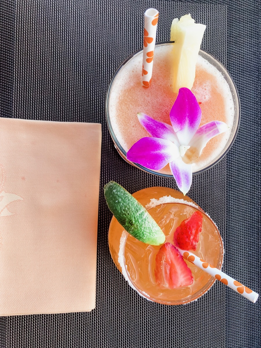 Paper straws with orange plumeria motif at Manta. Above: the hotel's signature drink. the Fredrico; below, a strawberry lilikoi margarita.