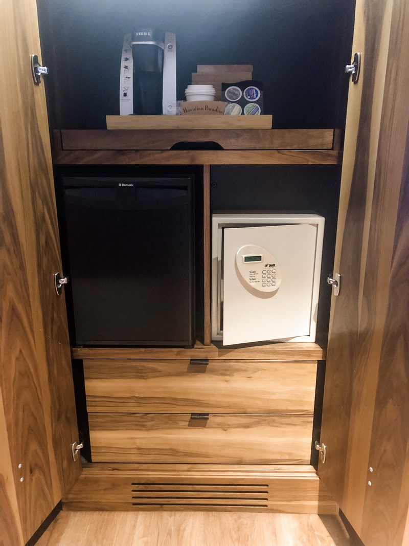Coffee maker, safe, empty fridge, and drawers for longer stays