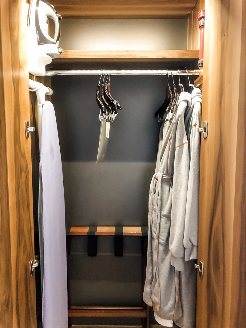 Iron, ironing board, robes, suitcase valet