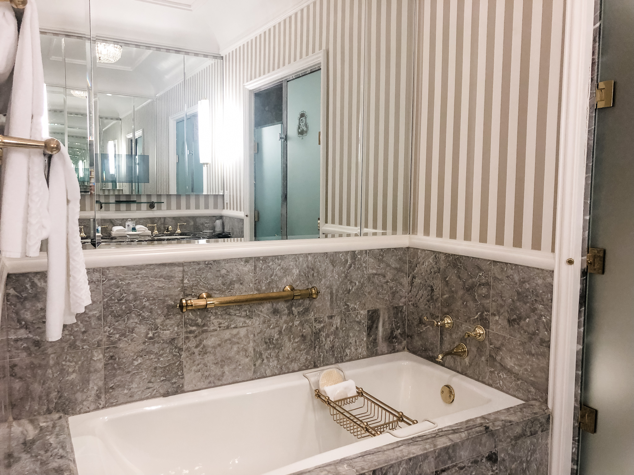 Marble tub + separate shower and water closet