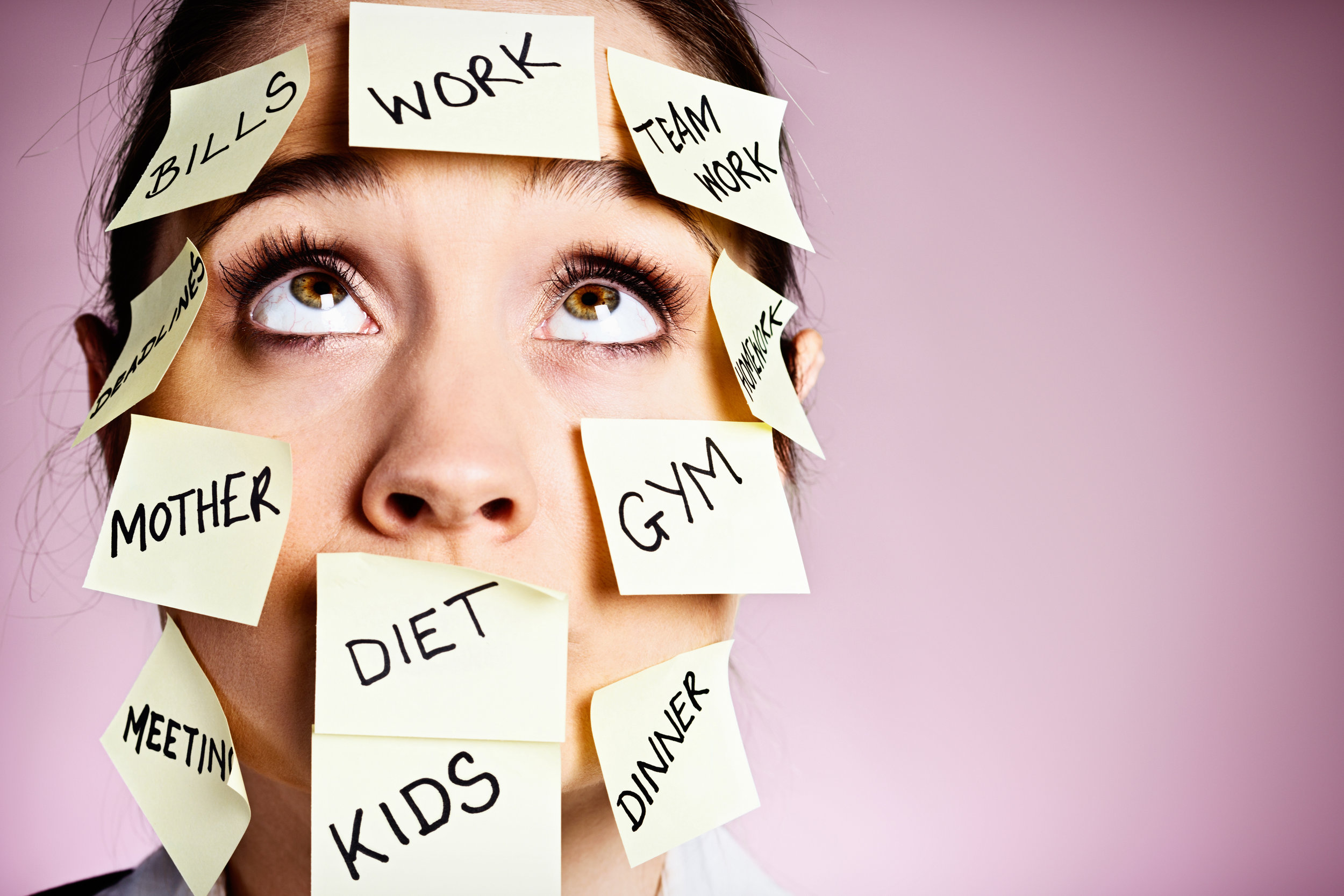 Frustrated-woman-covered-in-stiocky-reminders-rolls-her-eyes-453539161_3867x2578.jpeg