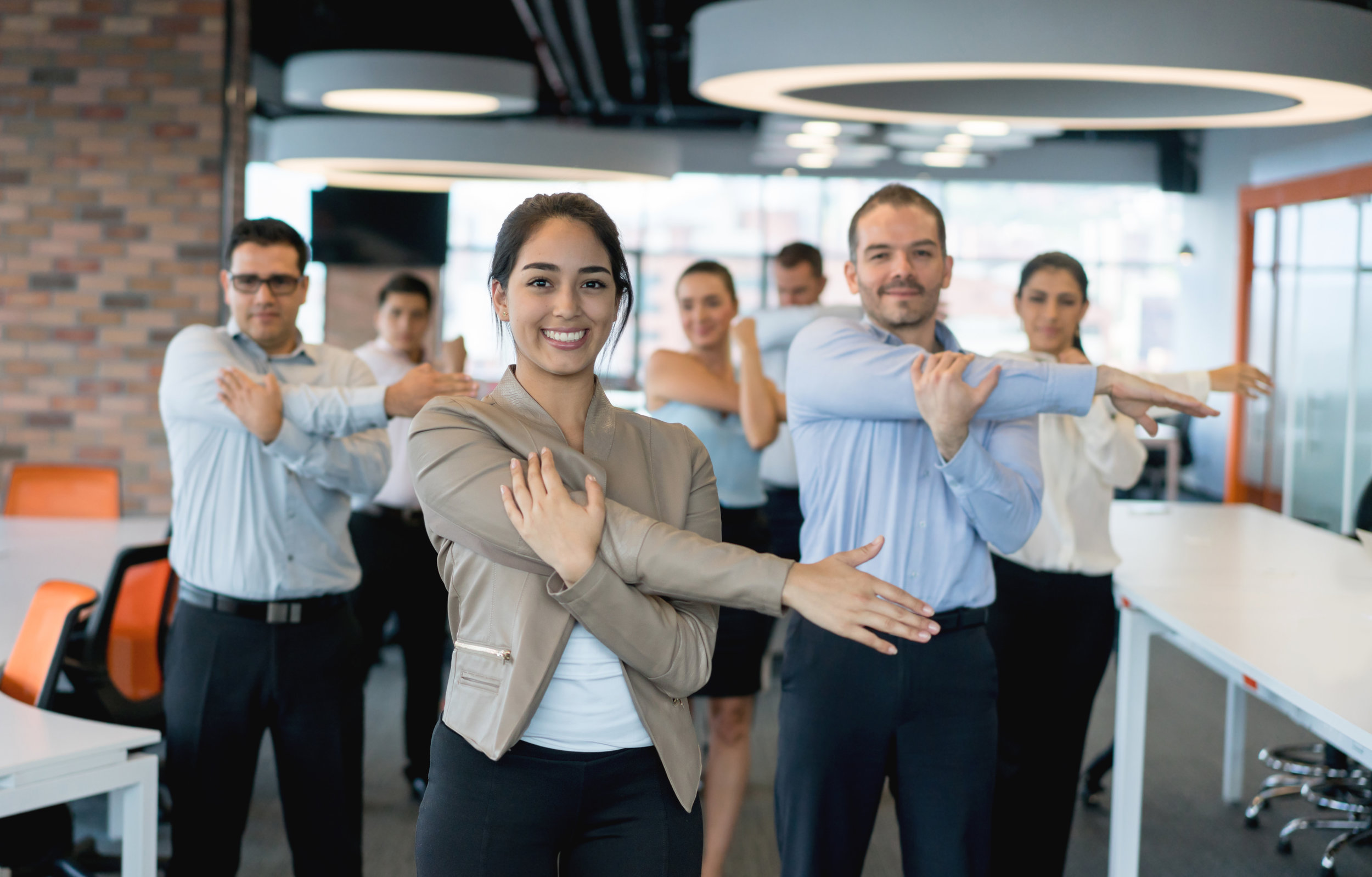 Business-people-stretching-at-the-office-878692208_6985x4467.jpeg