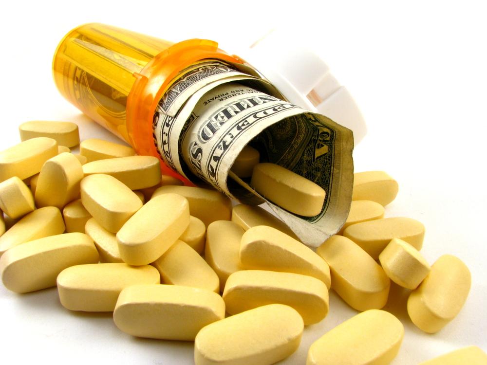 Prescription-bottle-and-dollars.jpg
