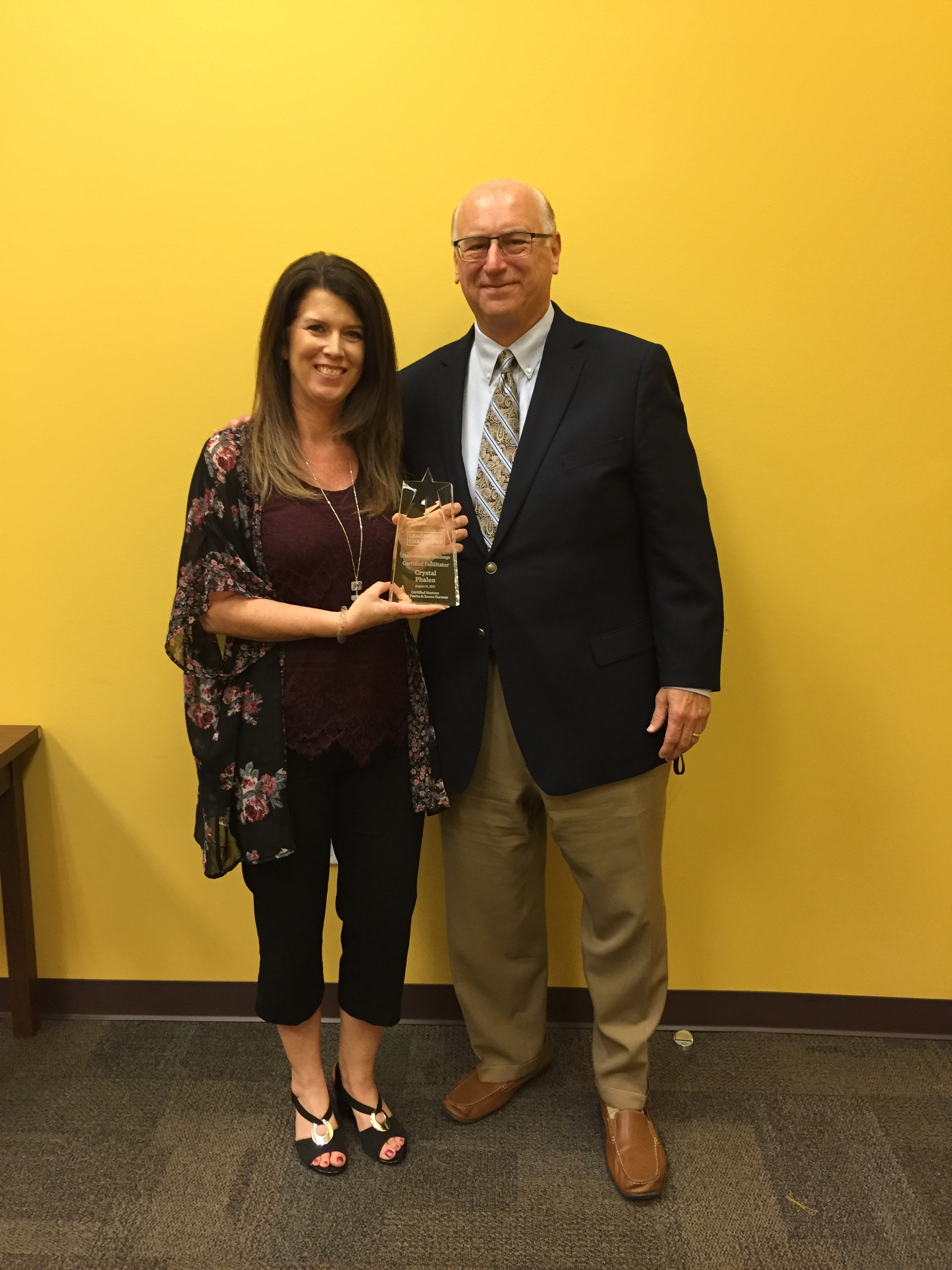 Tom with Crystal Phalen as she achieves her Certified Facilitator award.