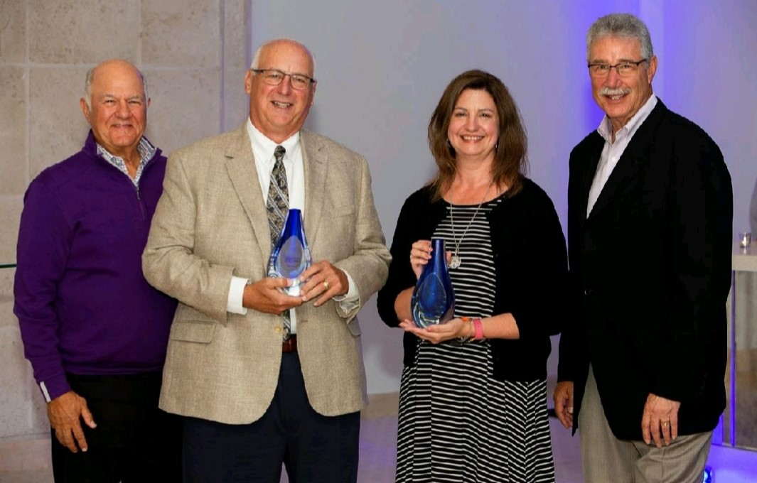 """Tom Pearce and Renee Harness receive the """"Star Player"""" award from Jim Kouzes and Barry Posner at the 2019 Leadership Challenge Summit in West Palm Beach, Florida. Note: This is Tom's second time to receive this award. First time was 2015."""
