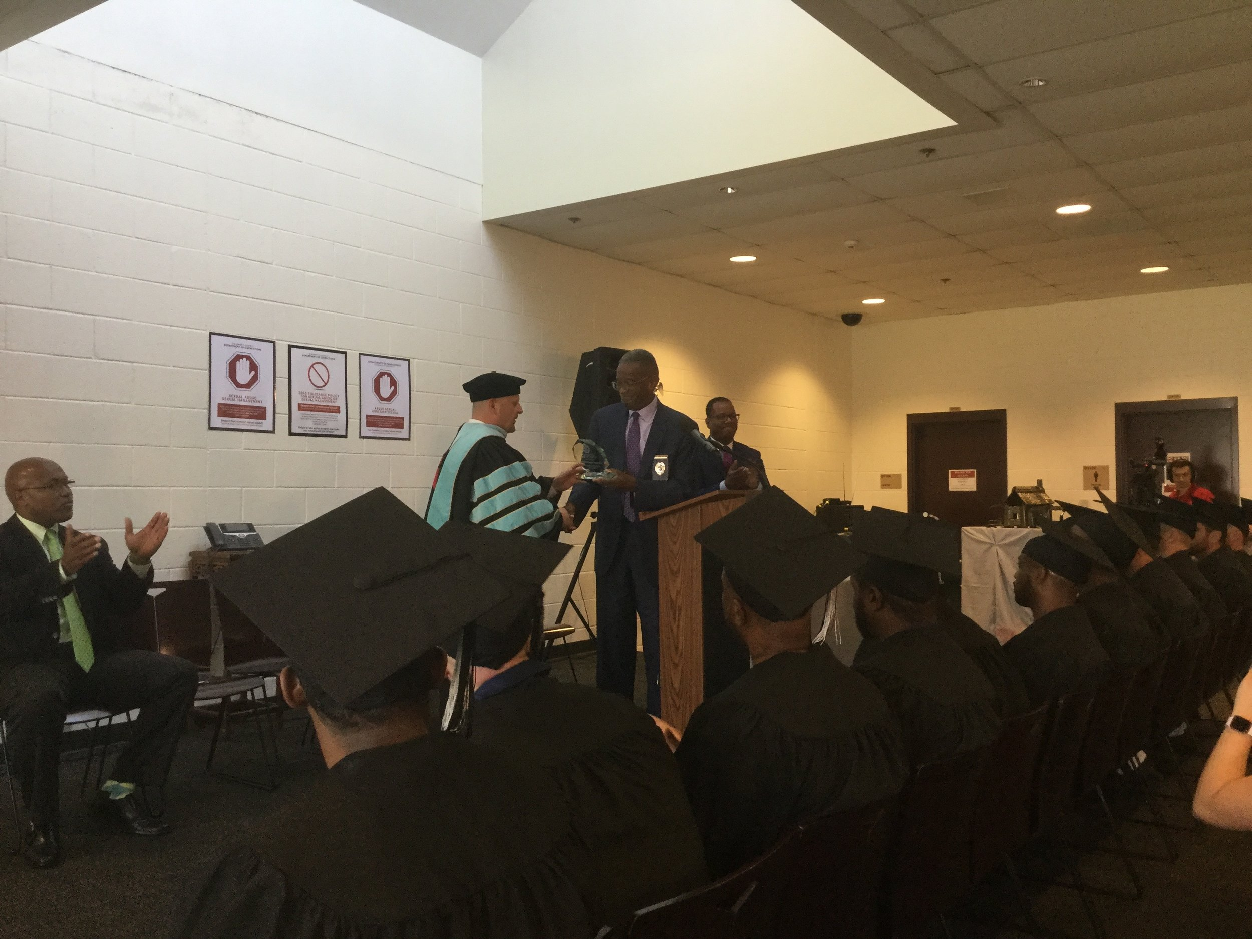 Gwinnett Correctional Warden and Gwinnett Technical College Dean distribute GEDs and awards to the graduating class.
