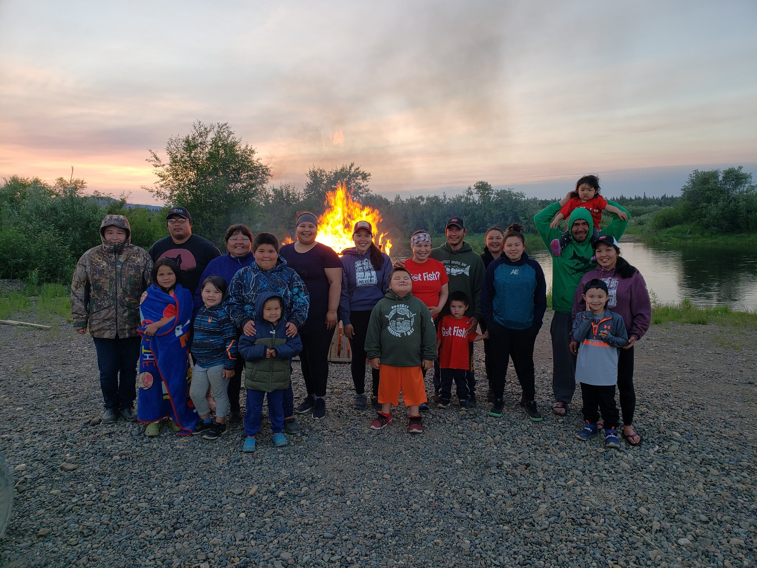 Koliganek residents stand by a July 28, 2019 bonfire to send an SOS to Alaska's congressional leaders on Pebble. Subsistence, sport and commercial fishermen throughout Bristol Bay lit fires and flares to send a distress signal. Photo by Delores Larson