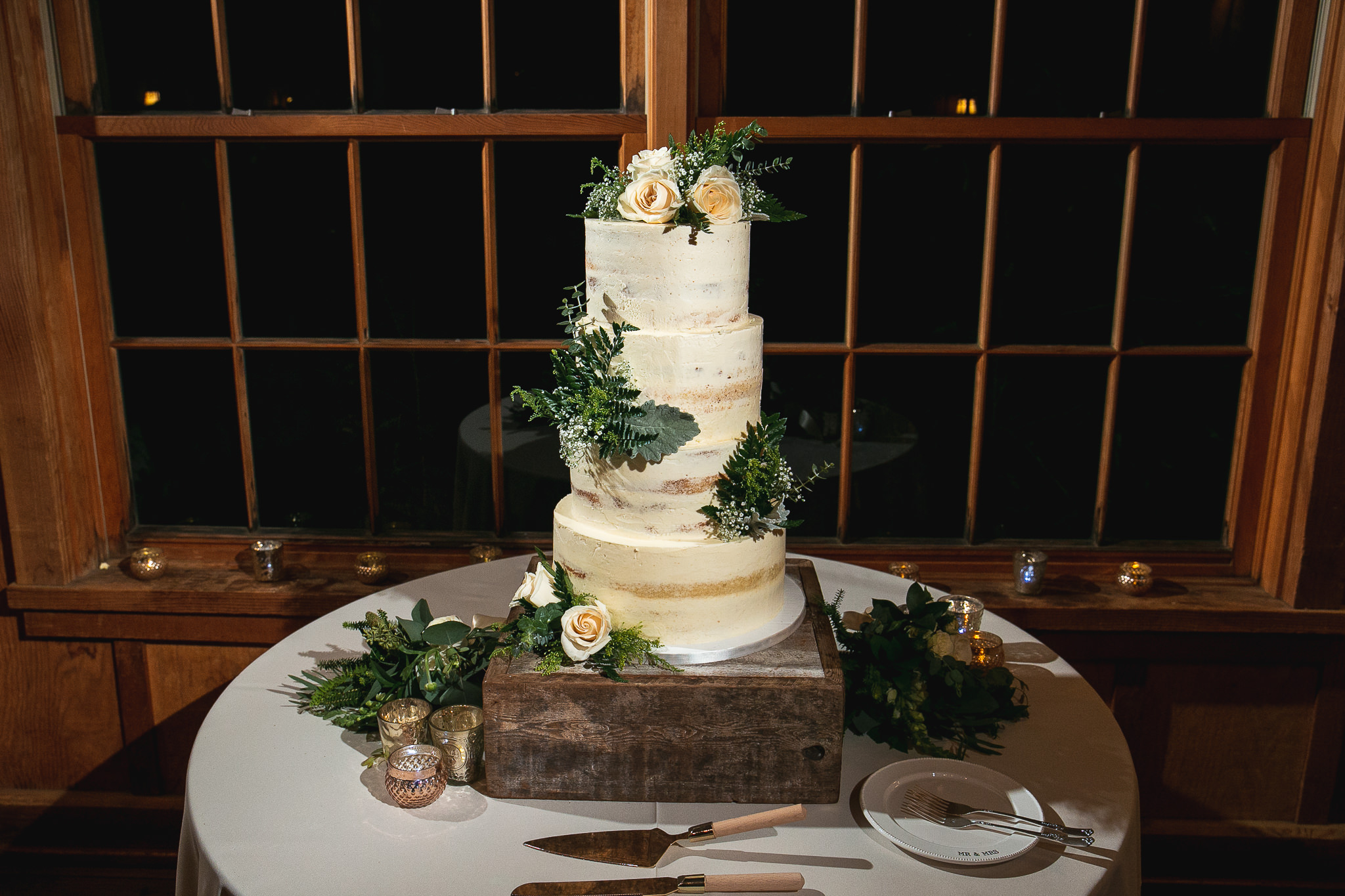 This amazing multi-tiered wedding cake was created by Etta Avenue Cakes