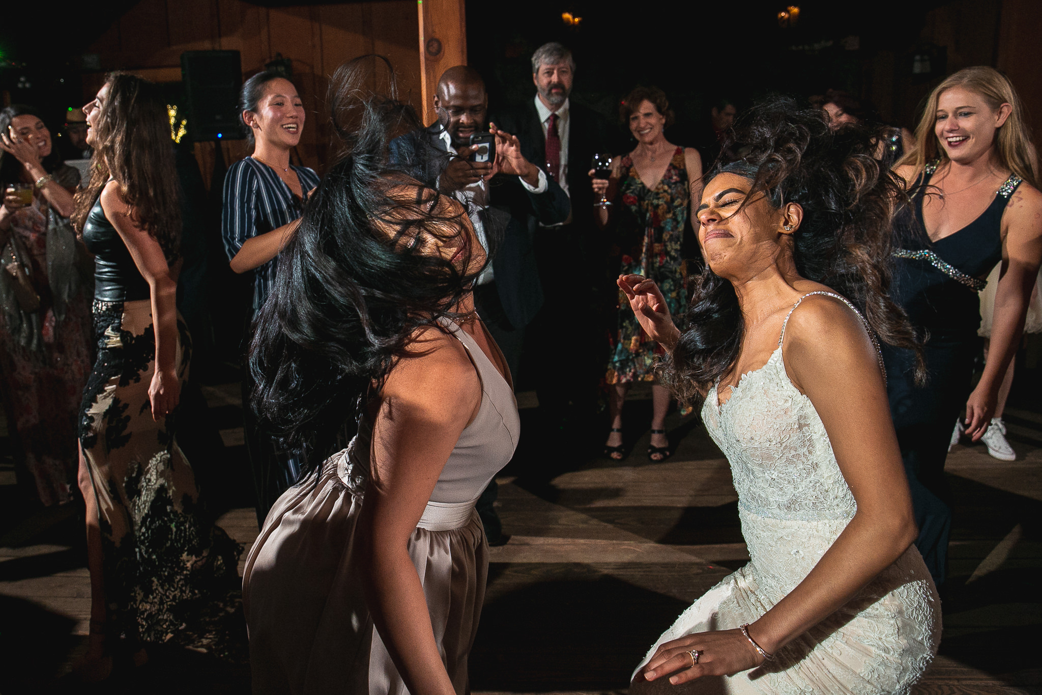 We love working with brides and grooms who know how to get down! You'll often find us dancing along as we're working.