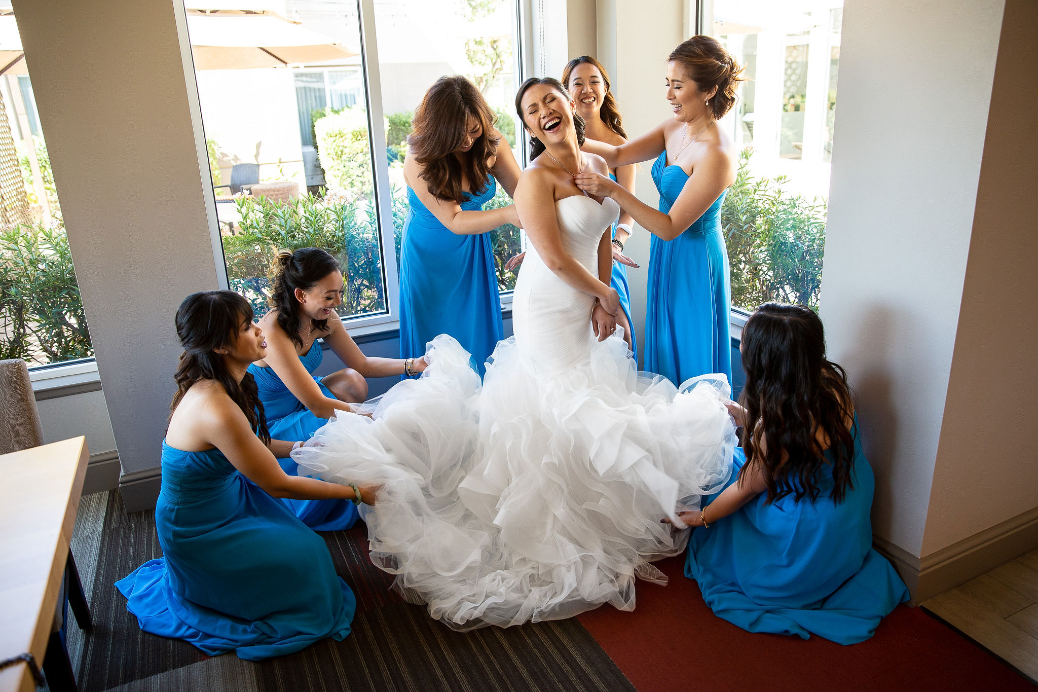 The bridesmaids were just making sure she's all put together and ready to marry her man. Apparently it is a very fun activity :D