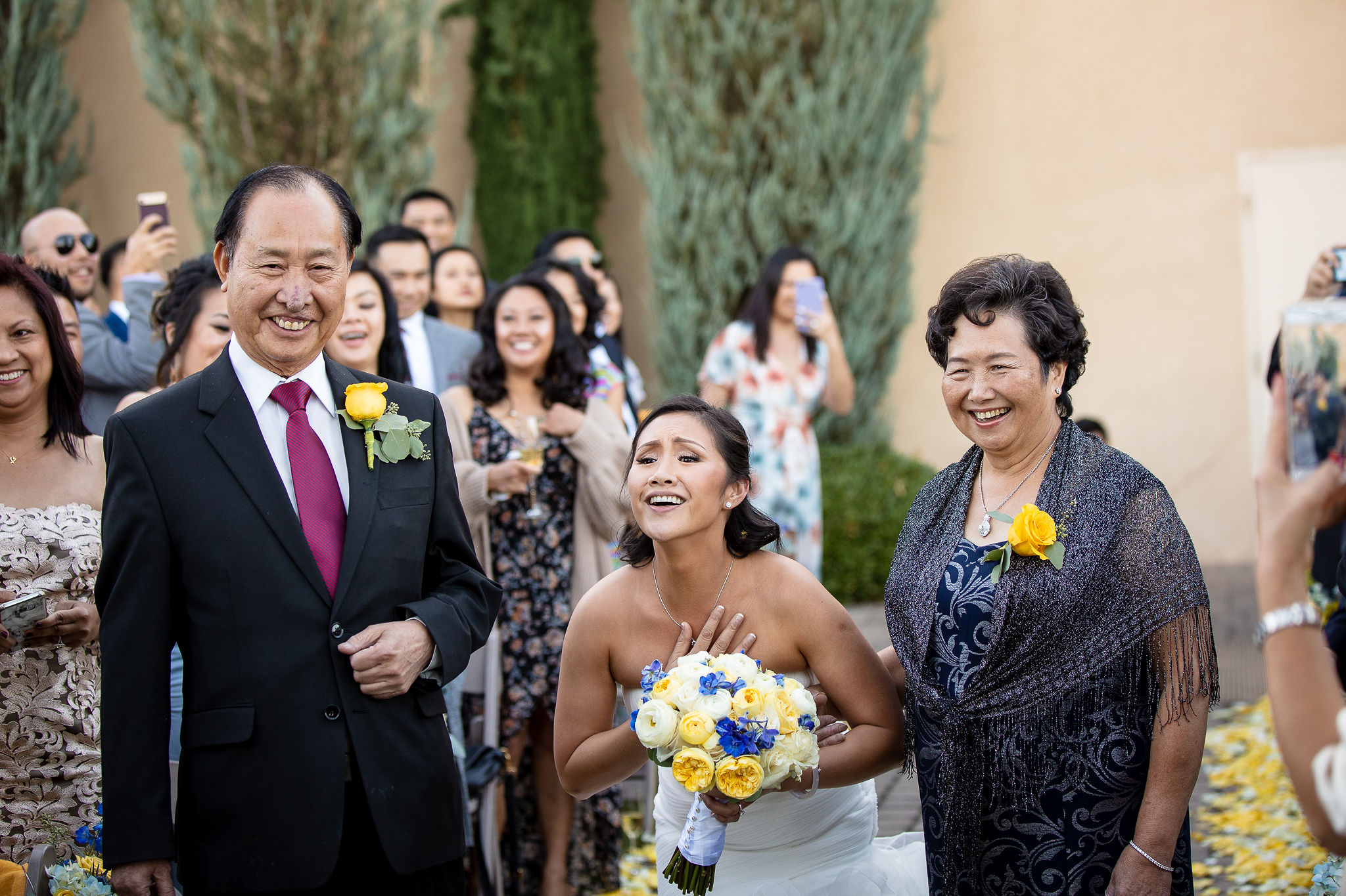 """I. LOVE. THIS. Karen sings """"Alive"""" by Krewella (Acoustic Version) to Jeff as she walks down the aisle during the ceremony procession."""