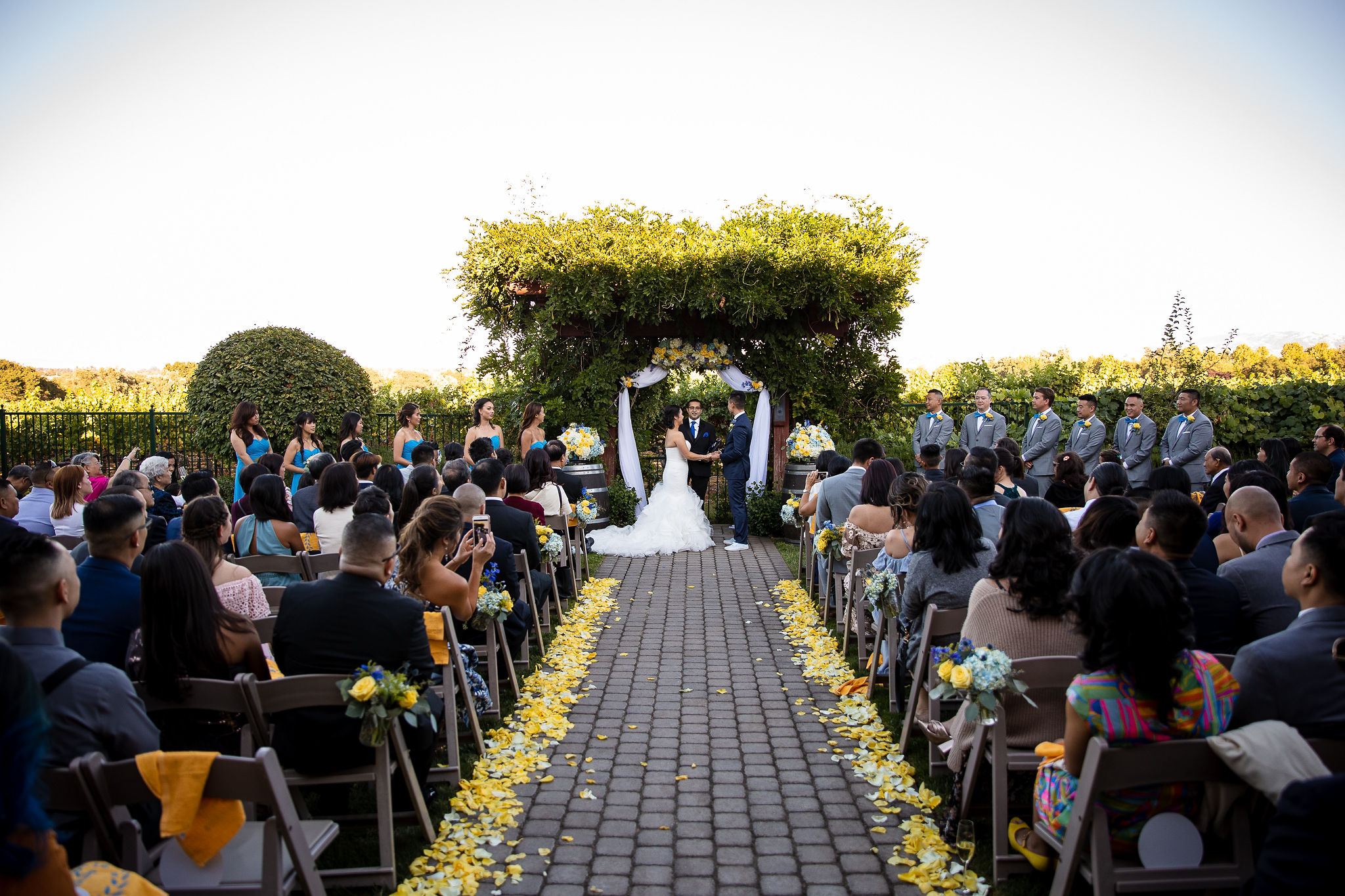 The Palm Event Center in the Vineyard, located in Pleasanton, CA, is one of the premiere venues in the East Bay. We love the lush arches for the ceremony, conveniently located just outside the dining reception area.