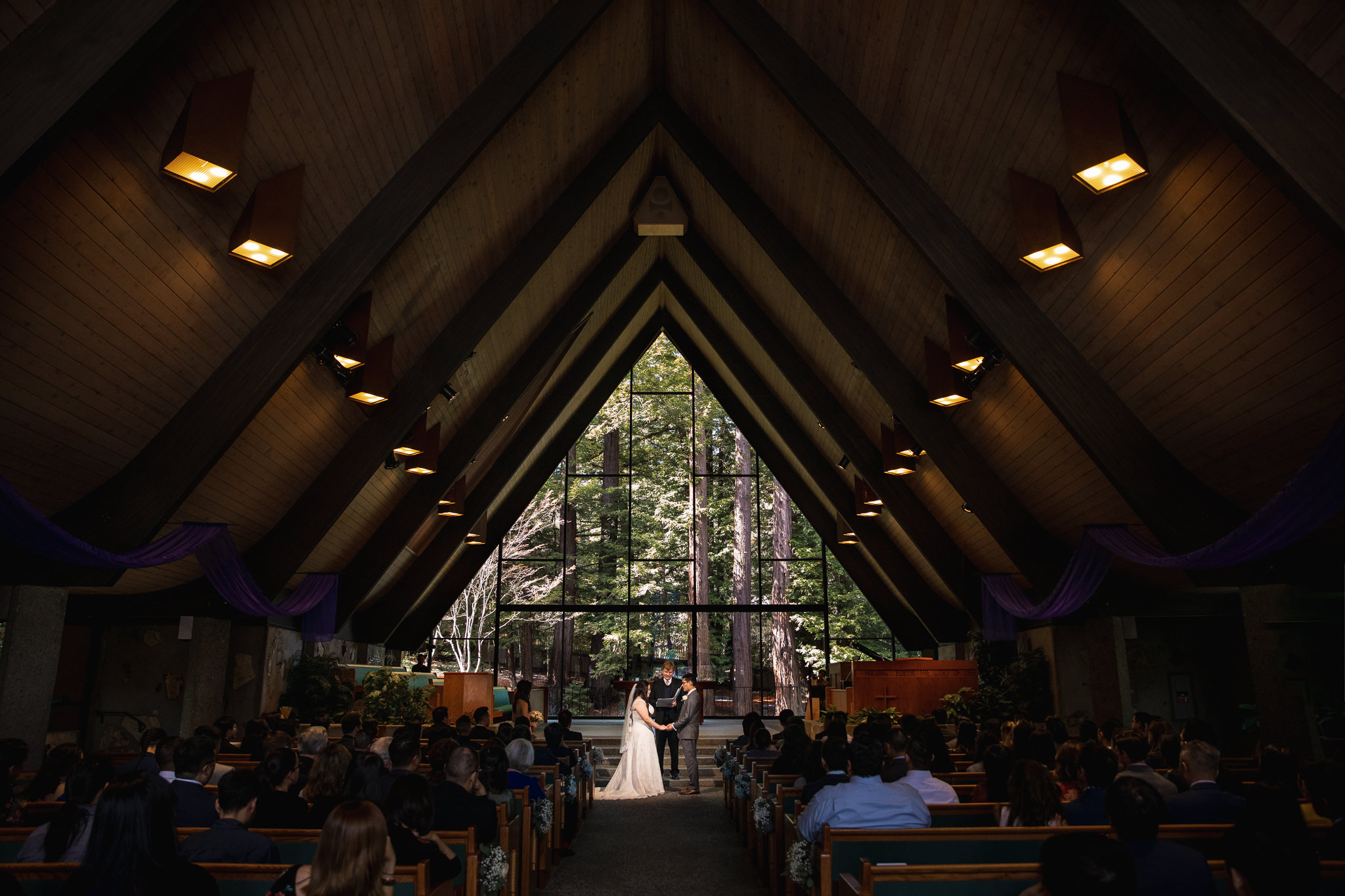 The Valley Presbyterian Church in Portola, California, features a unique rooftop structure and a forest backdrop. It's hard not to enjoy nature when attending wedding ceremonies here.