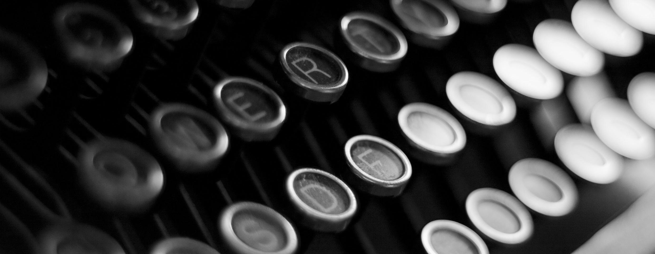 alphabet-black-and-white-blur-938165.jpg