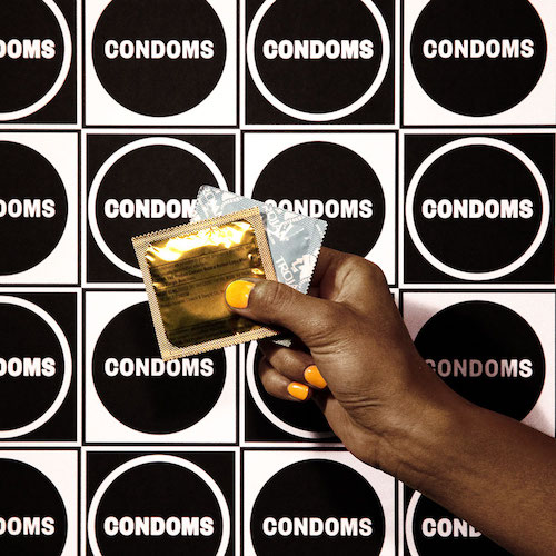 CONDOM - A condom is a stretchy pouch worn over the penis during sex. It blocks fluids going from the penis to the vagina or anus (butt) - meaning it prevents pregnancy and STDs.