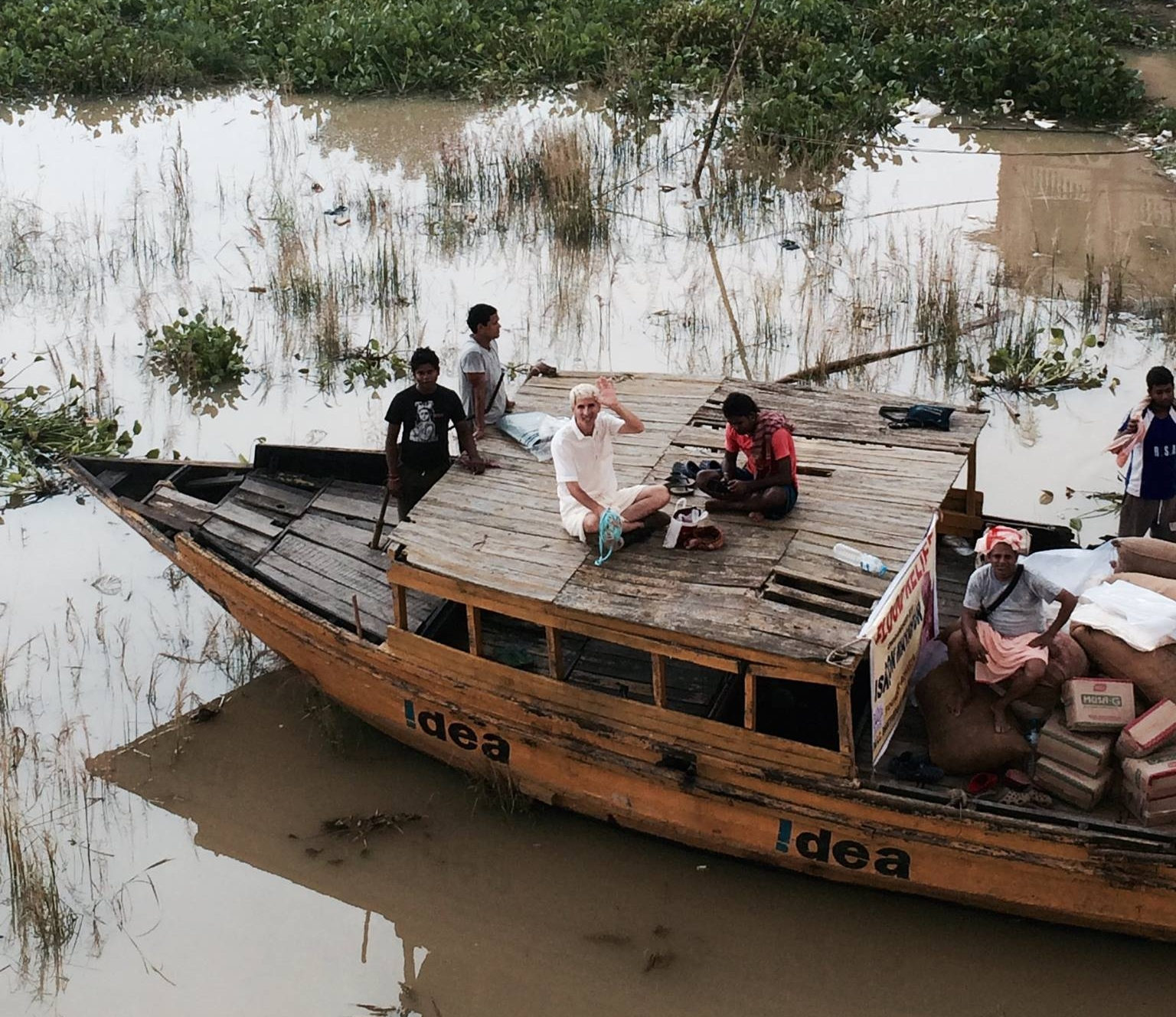 Jay helping delivery food to villagers stranded  due to flooding in India.