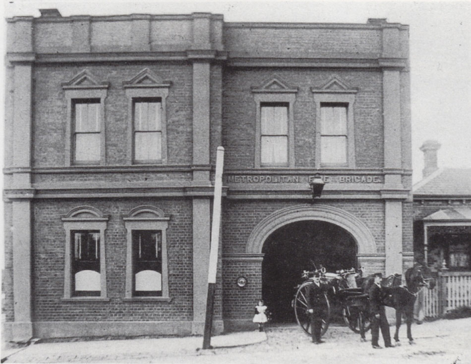 Northcote Fire Station No. 13. Firefighter Frank Moorman and Walter Griffiths outside the station along with Esther Moorman, aged four, 1905. Fire Services Museum collection.