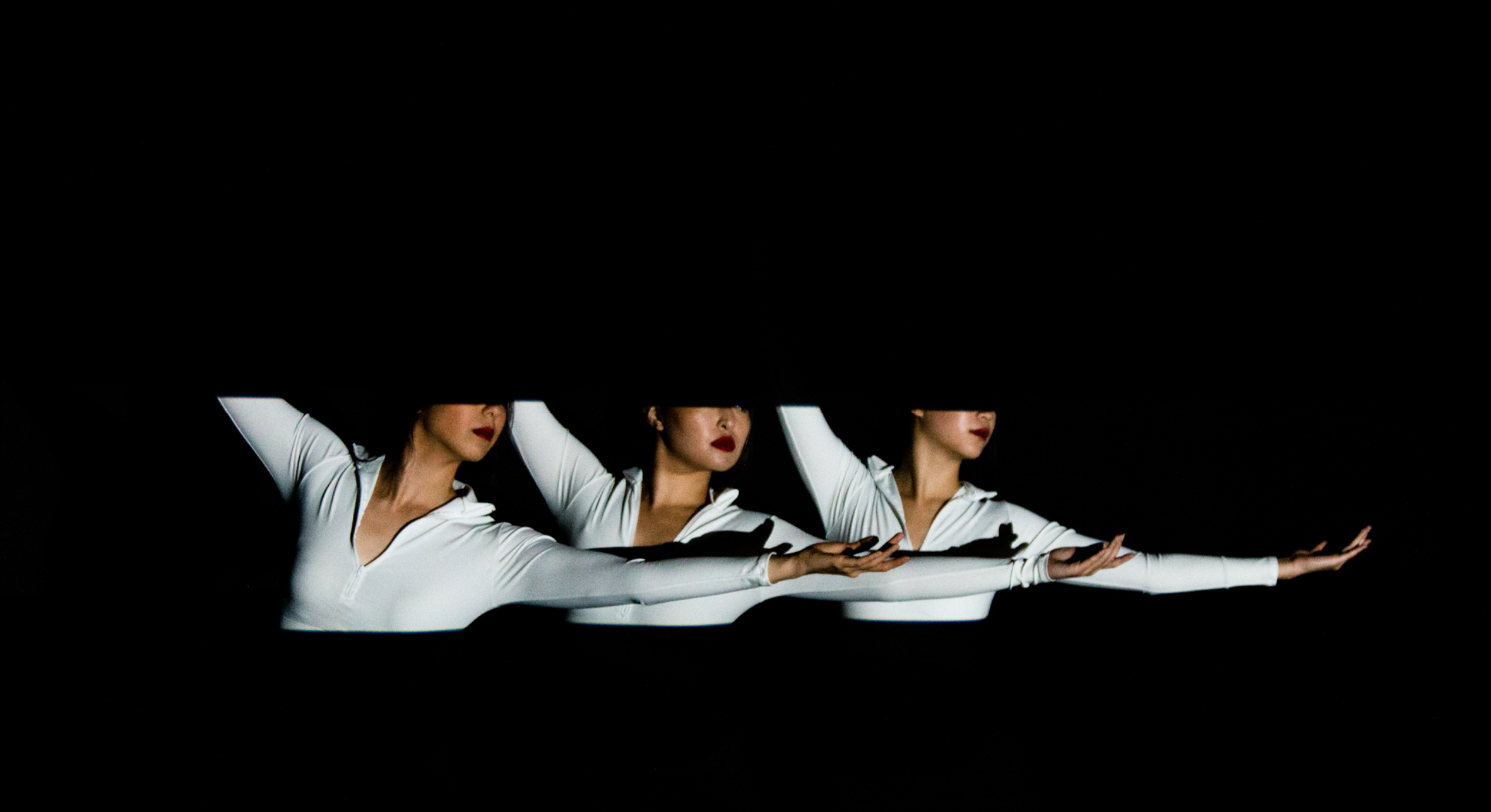 Frame    Figure ground compositions animated through projected light highlight specific movements of choreography, as these three dancers move in and out of each others' frames.  Shot May 2018  Live Performance location - Evoke Dance Studio  Dancers - Joann Hsu, Jaclyn Wang, and Nina Wang  Creative Directors - Erin Cuevas, Philip Lu, and Joy Dayaw  Choreographers - Phillip Lu, Joy Dayaw  Producers - Erin Cuevas, Jana Masset Collatz, Jan Collatz, Joy Dayaw, and Philip Lu  Editor - Luke Kraman  Director of Photography and Colorist - Philips Shum  First Assistant Camera - Mark Armenta  Gaffer - Jamers Suter