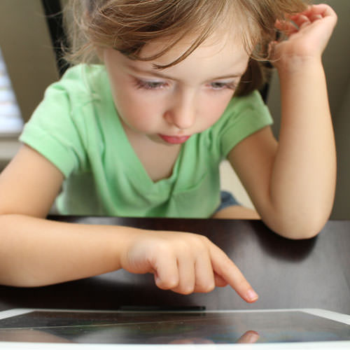 little-girl-playing-edugames-plus-on-a-tablet-edugames-plus-fixate.jpg
