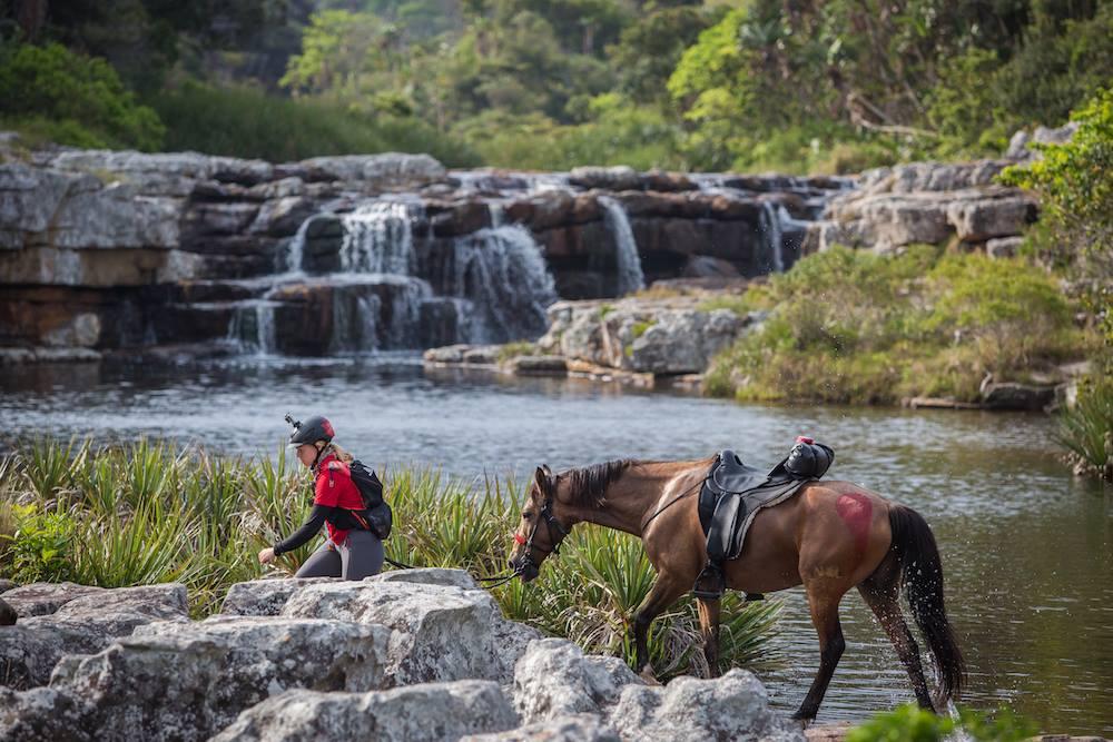 Sarah-and-Gerber-crossing-a-waterfall-during-Race-the-Wild-Coast-PC-Rockethorse-Racing.jpg