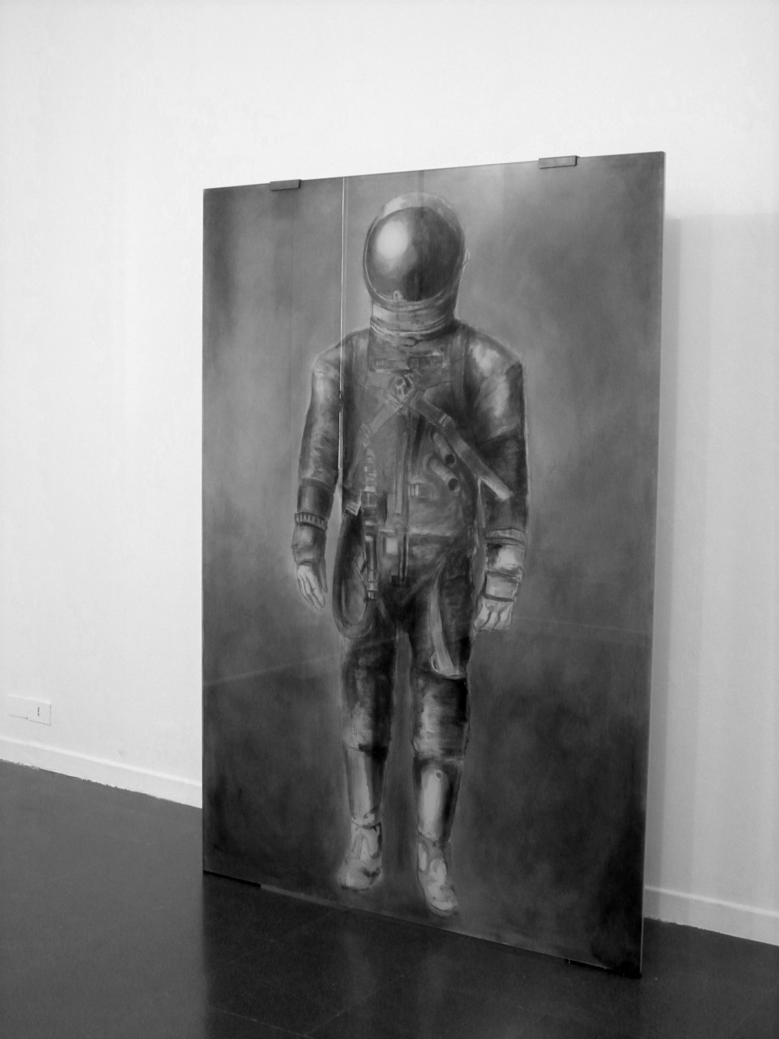 view of the installation of astronautenanzug at the fondazione mudima.