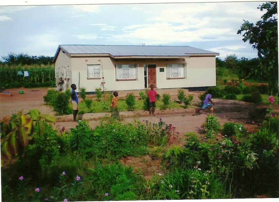 Children playing in front of one of the houses