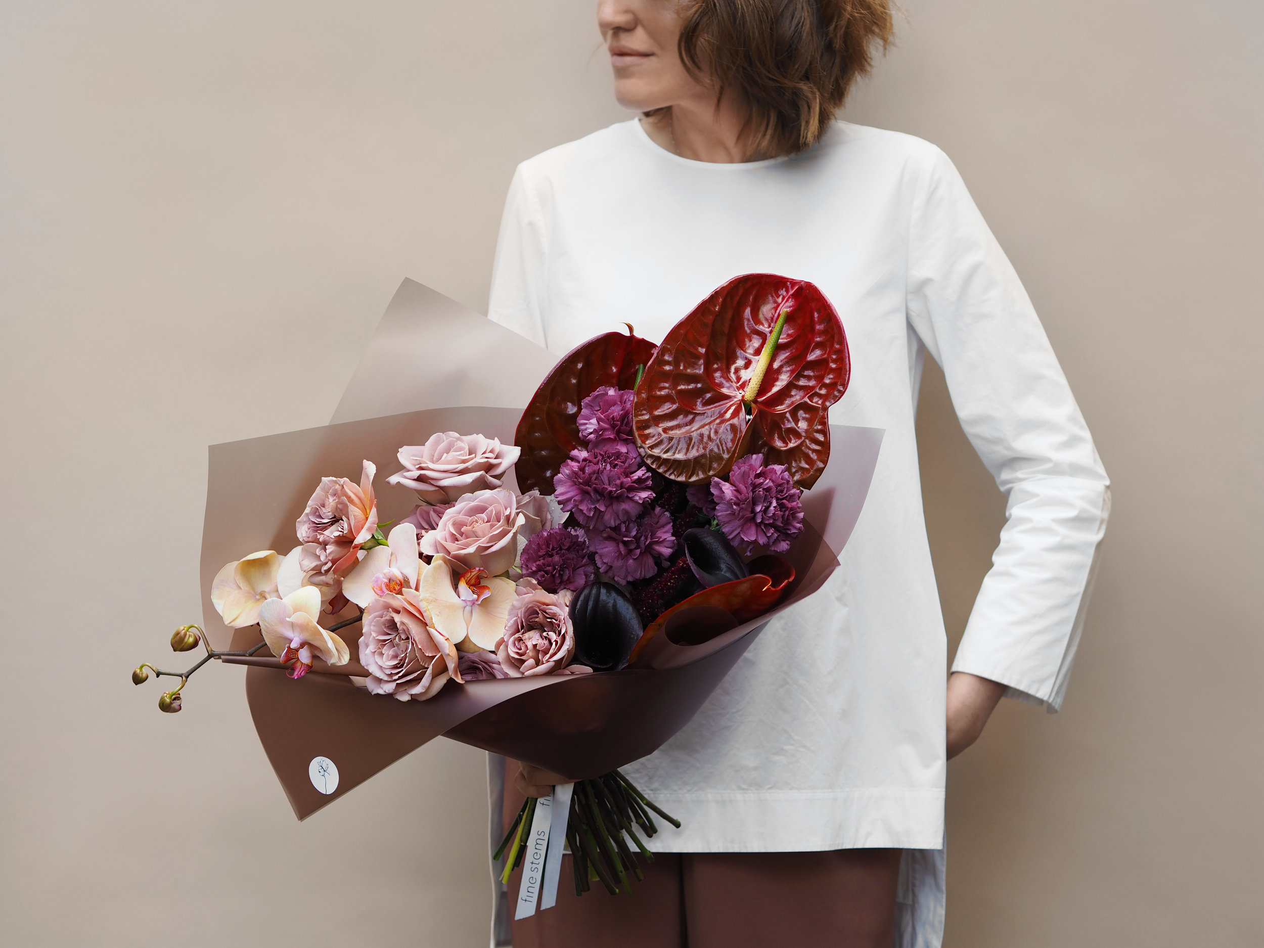 No. 1 - This bouquet is made from a mix of premium large Roses and Carnations in a variety of colours, cut stems of Orchid, Ricinus, Anthurium and black Calla Lilly.