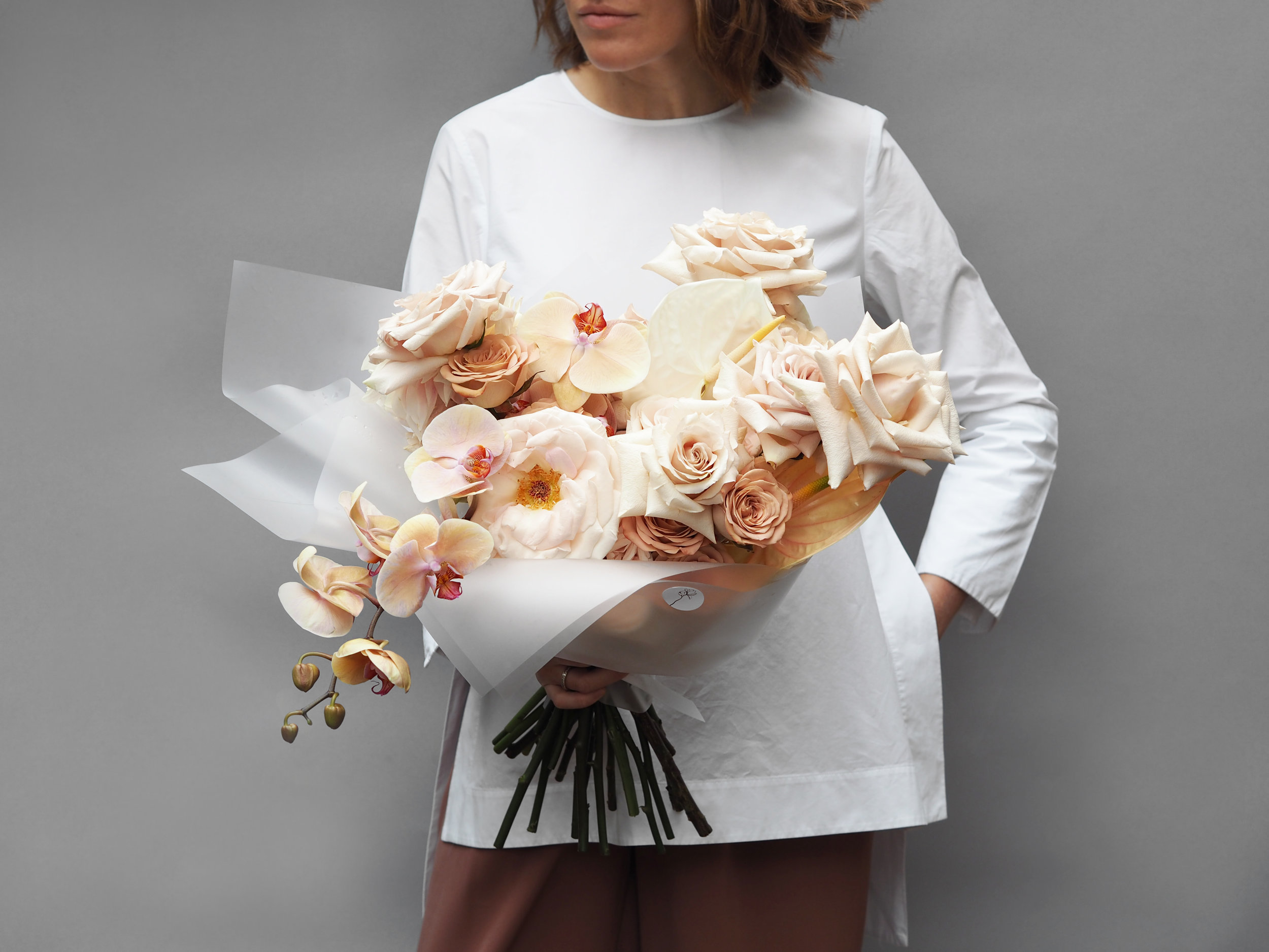 No. 1 - This large decadent bouquet is created with of mix of premium Roses, cut stems of soft apricot Orchid Phalaenopsis and Anthurium.