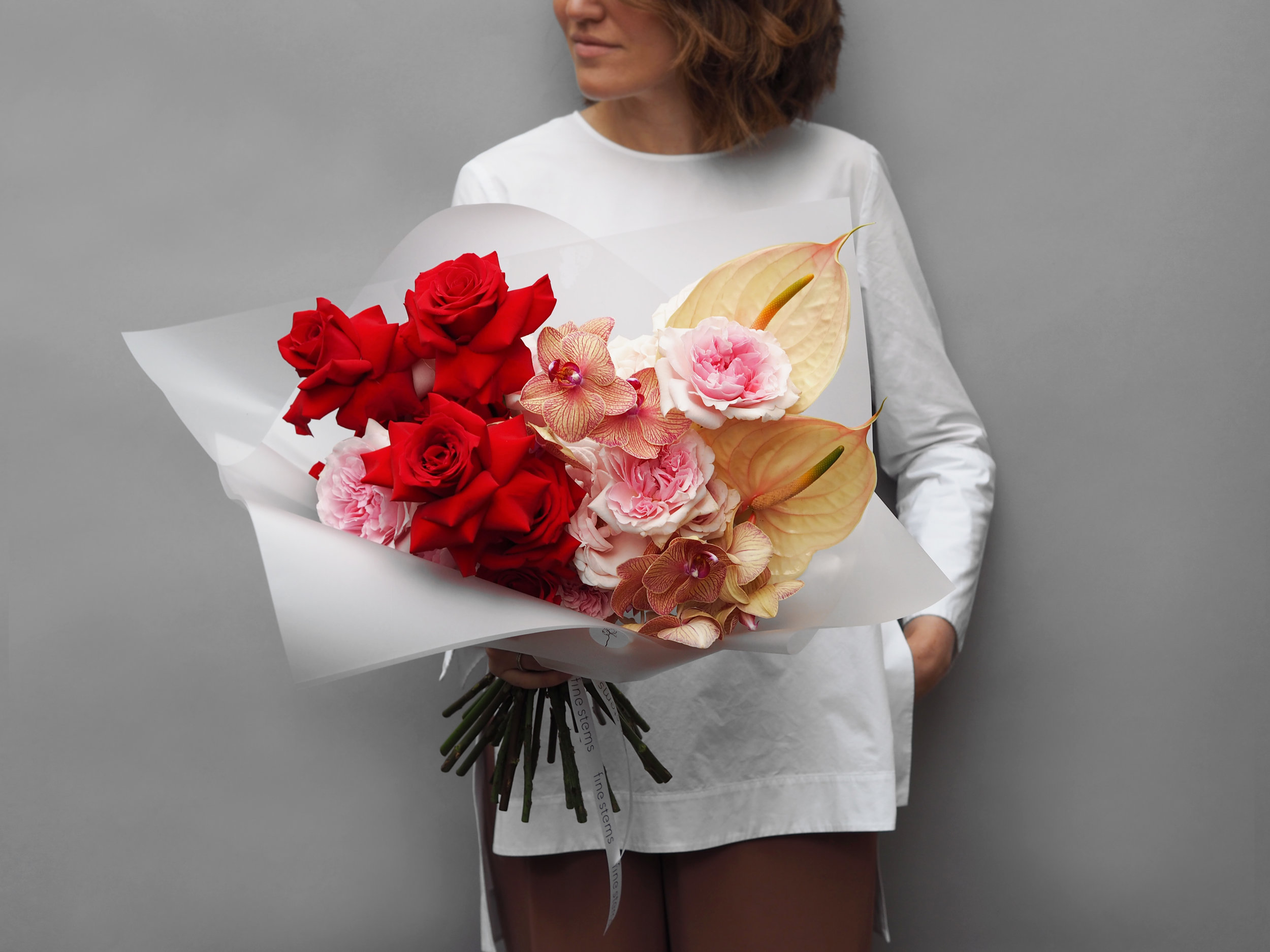 No. 2 - This large decadent bouquet is created with of mix of premium red and blush Roses, cut stems of Orchid Phalaenopsis and Anthurium.