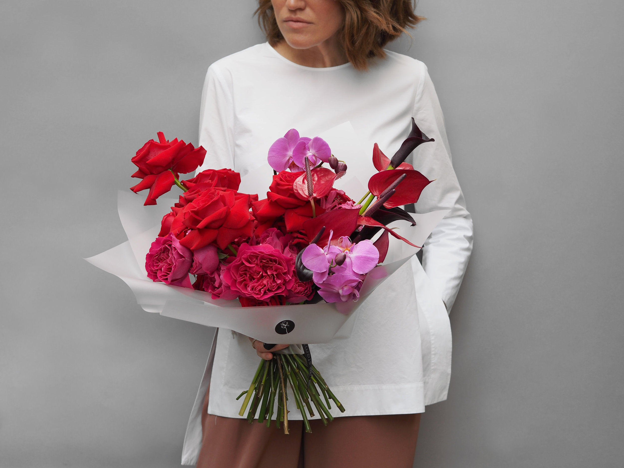 No. 3 - This large decadent bouquet is created with of mix of premium Roses, Calla Lilly, Anthurium and cut stems of Orchid Phalaenopsis in Magenta.
