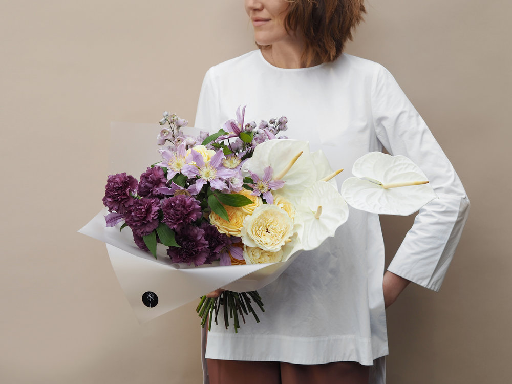 No. 4 - This bouquet is made from a mix of Carnations, premium large Roses, Delphiniums, violet Clematis, cut stems of Orchid and Strelitzia.