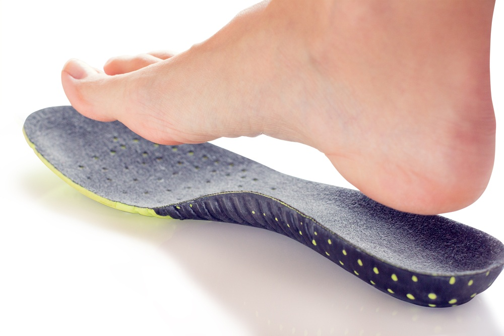 foot, heel, knee, back and hip pain relief with custom molded orthotics
