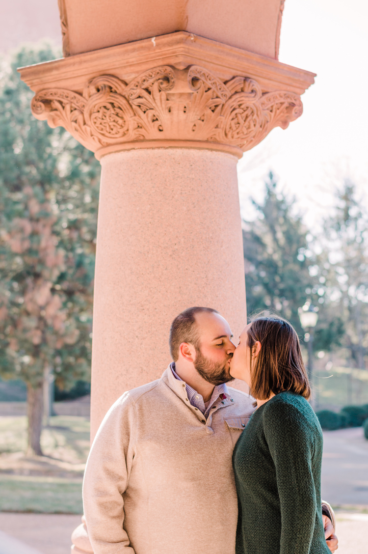 Surai Dohm Wedding Experience: a newly engaged couple kissing on the campus of St. Louis University