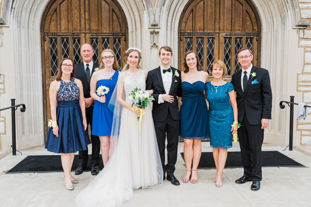 Surai Dohm Wedding Experience: bride and groom take a family photo outside of Central Presbyterian Church in Clayton, Missouri
