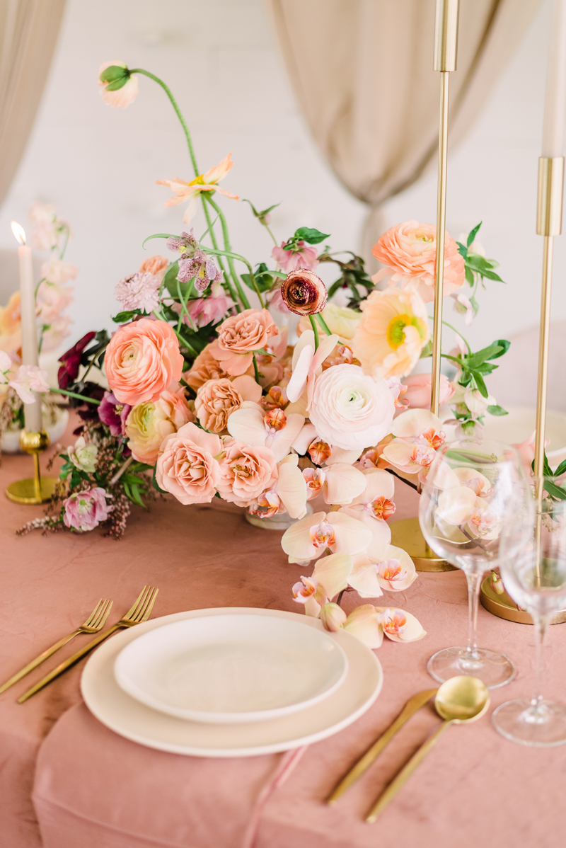 Surai Dohm Wedding Experience: a bouquet of flowers on a reception table