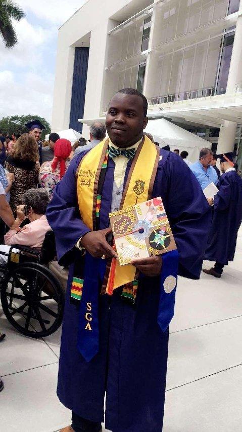Johnny Louis earns his engineering degree.jpg